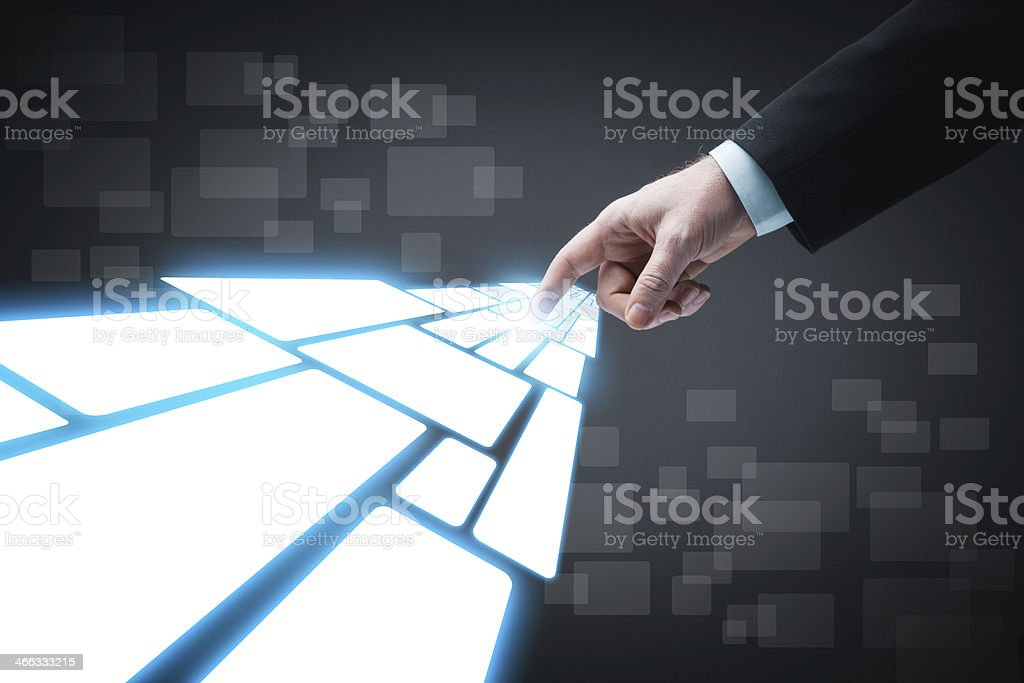Finger touching glowing digital touch screen stock photo