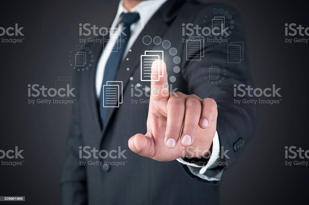 Finger touching loading file button on a touch screen stock photo
