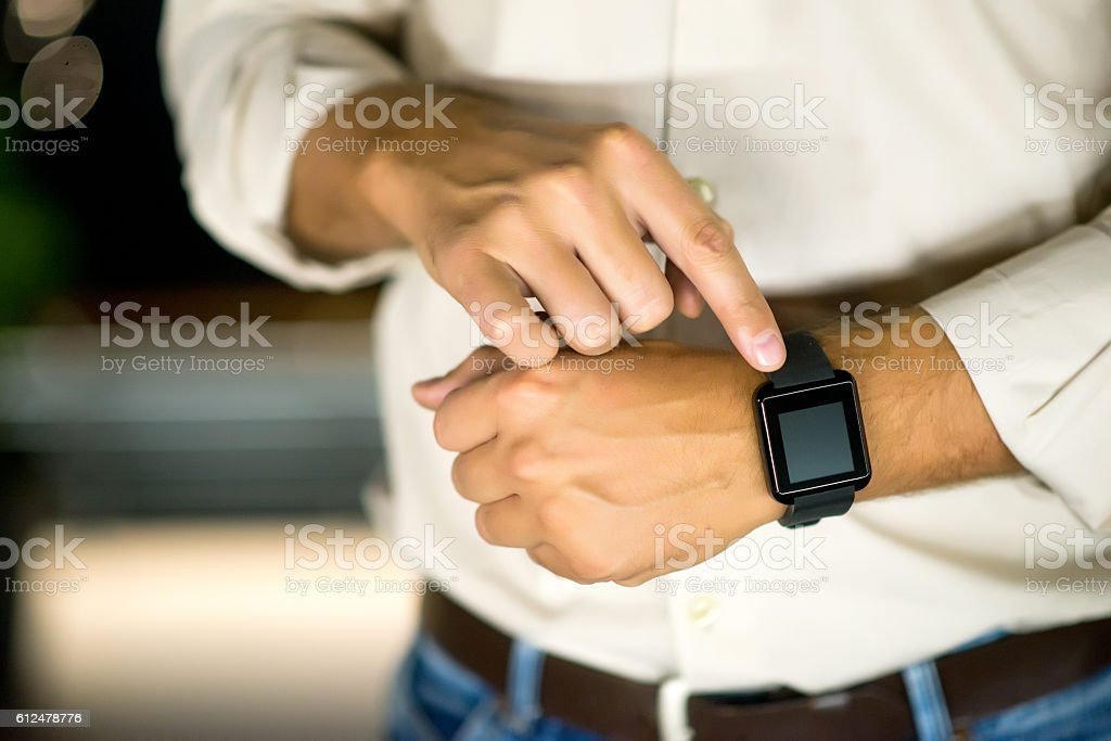 Finger Touching Smart Watch, Businessman Setting the time stock photo