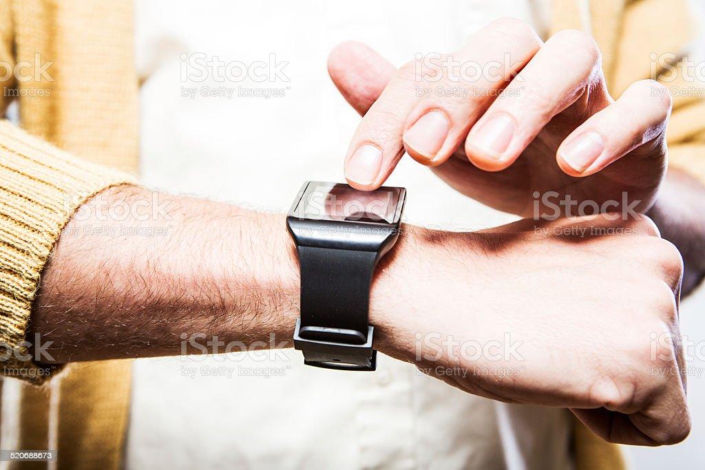 Finger Touching Smart Watch stock photo