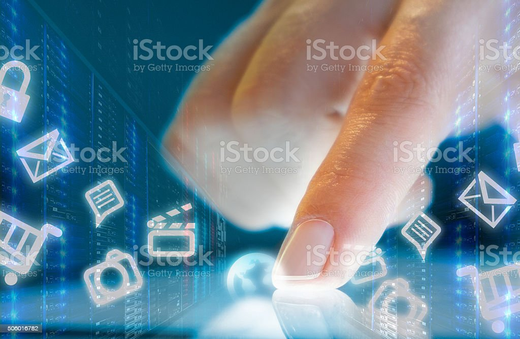 Finger Touching Transparent Digital Touch Screen in a data center. stock photo
