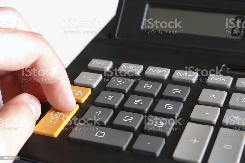 finger typing on calculator stock photo