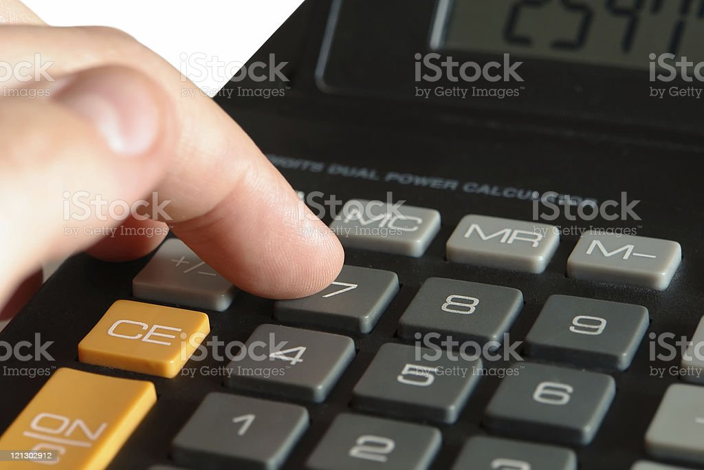 finger typing on calculator royalty-free stock photo
