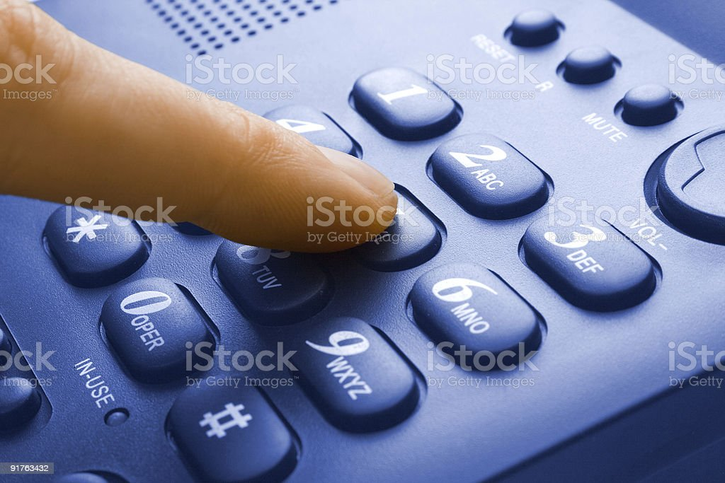 finger with green phone keypad stock photo