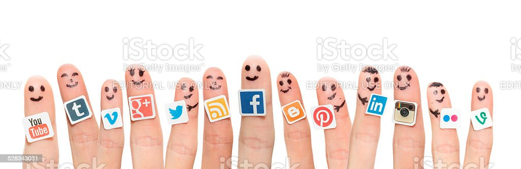 Finger with popular social media logos printed on paper. stock photo