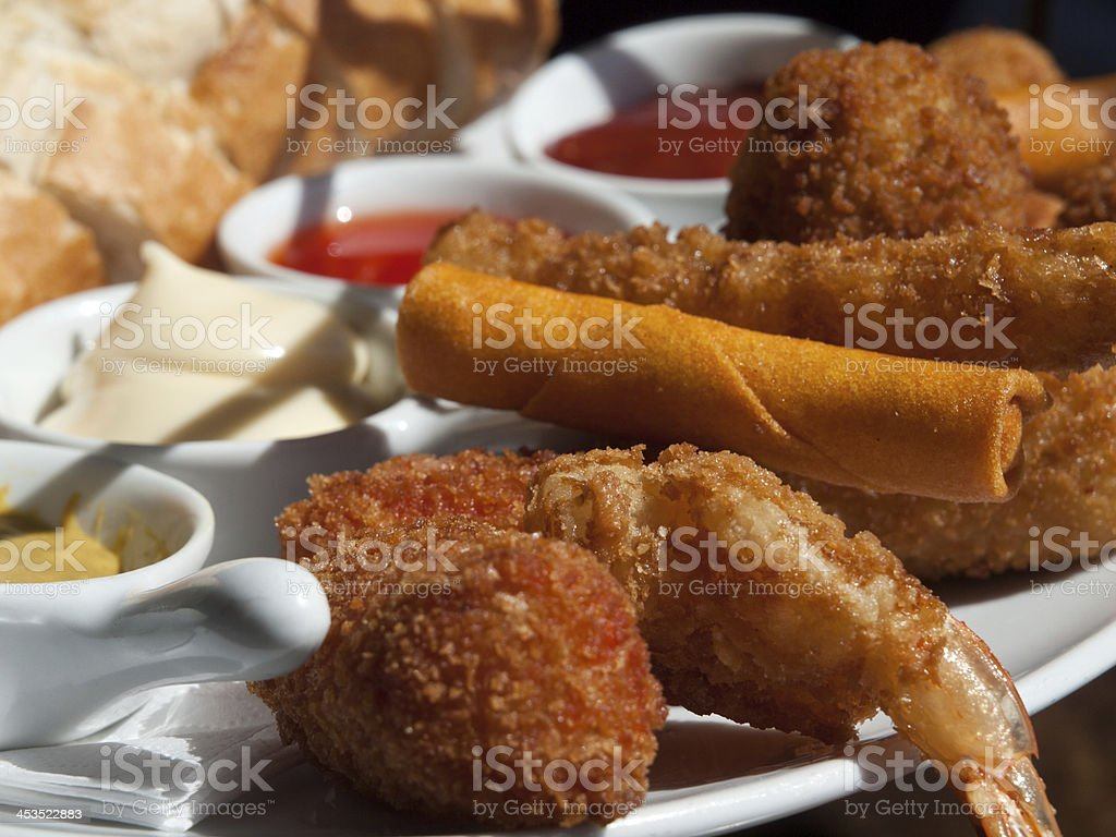 Fingerfood on a plate, springrols, bitterbal, bread, stock photo