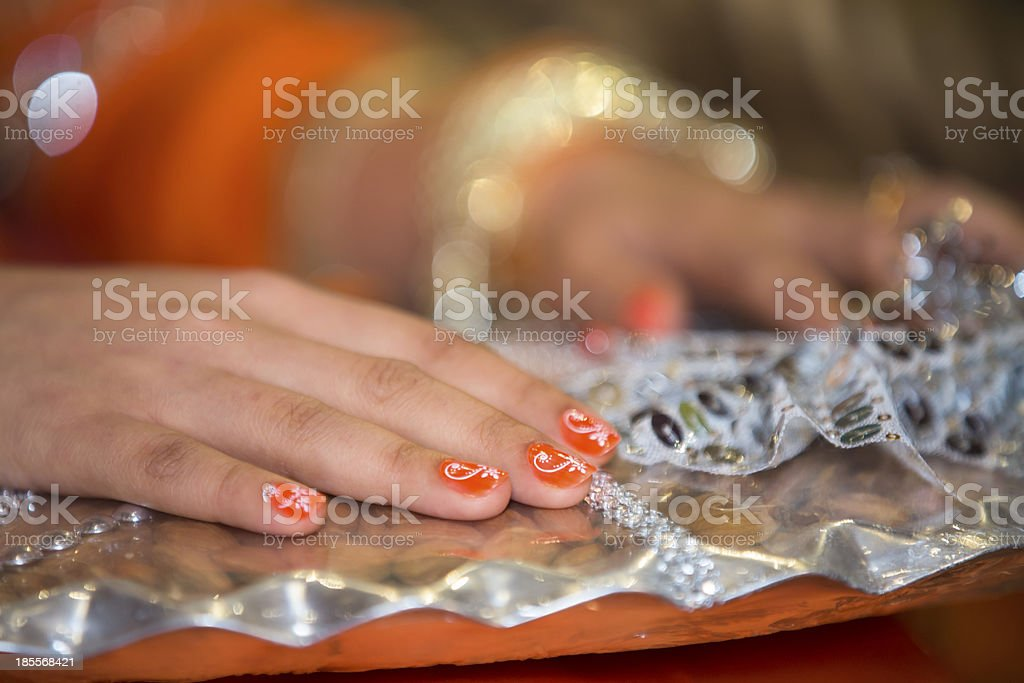 Fingernail decorations on a woman's hands. royalty-free stock photo