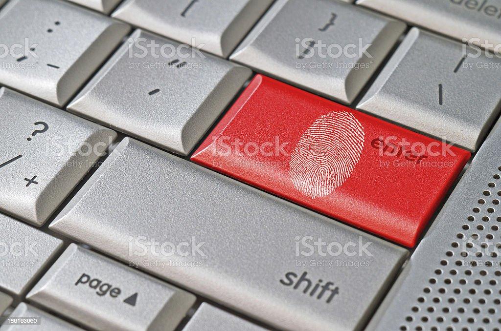 Fingerprint left on keyboard hack concept stock photo