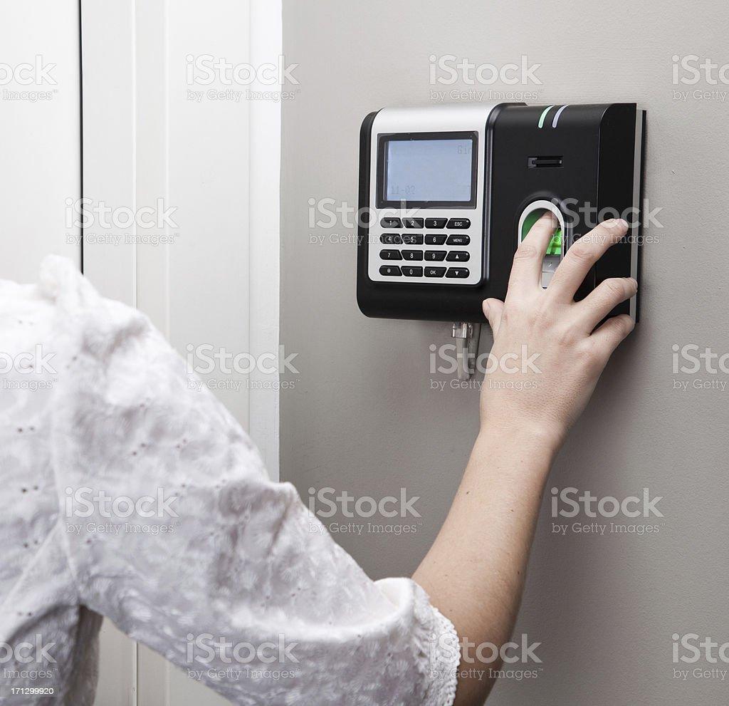 Fingerprint scan security door lock at use stock photo