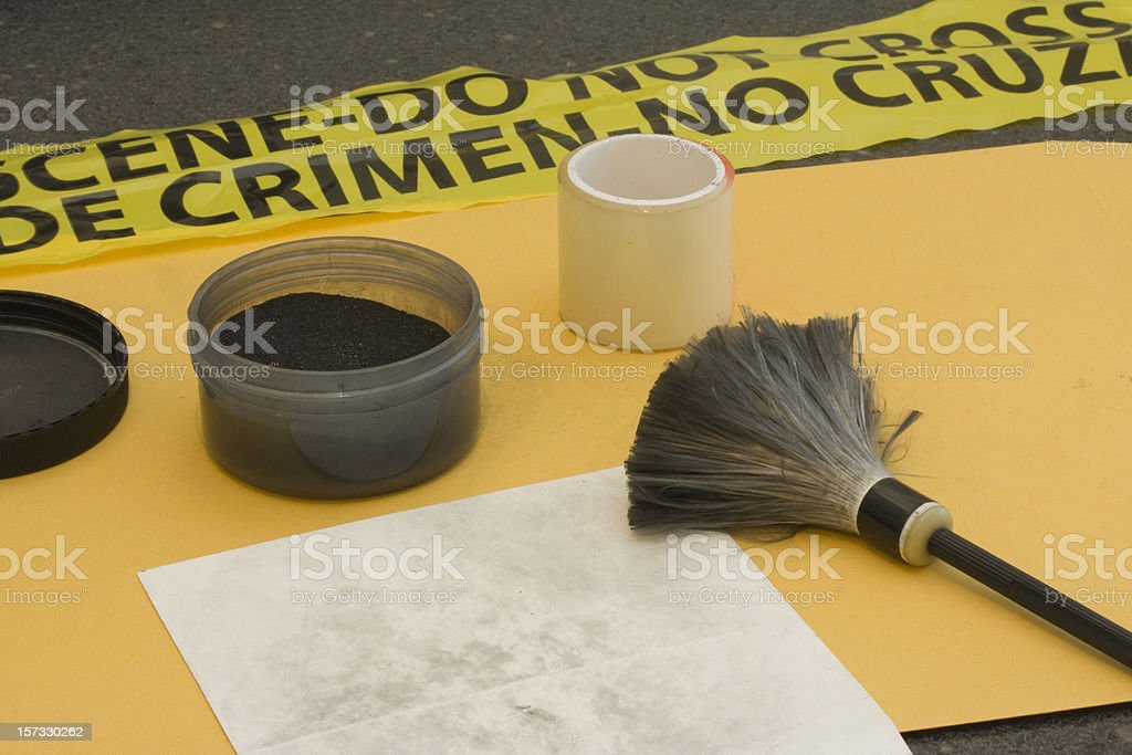Fingerprinting at a crime scene. stock photo