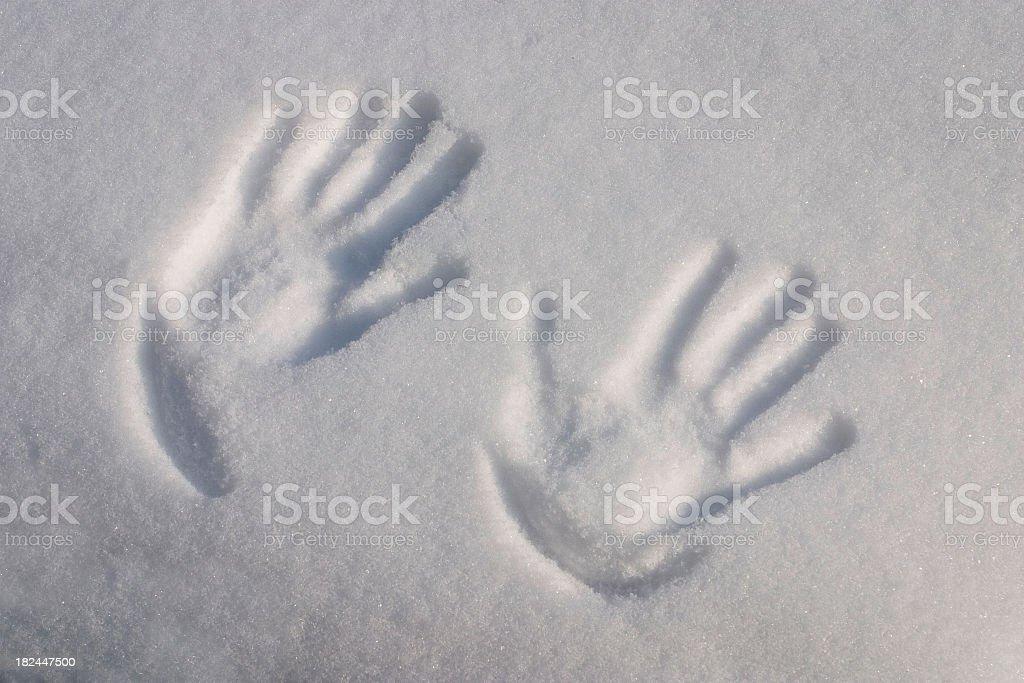 Fingerprints in snow stock photo