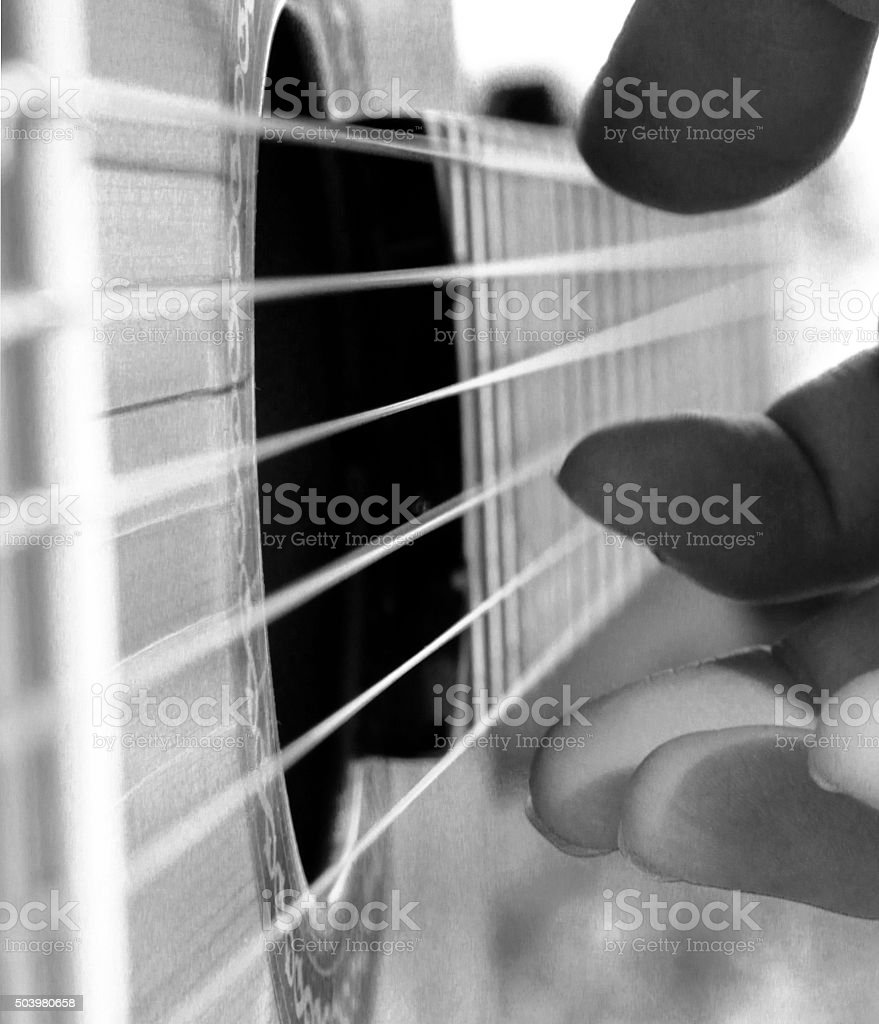 Fingers and Strings stock photo