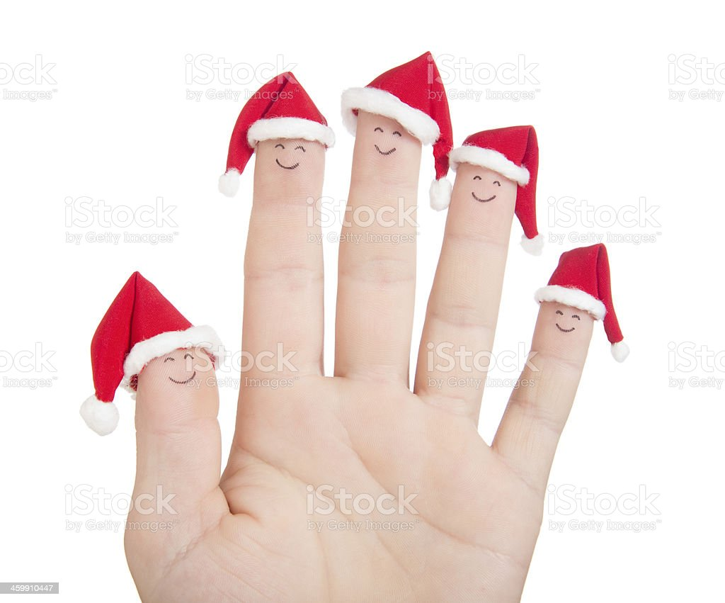 Fingers Christmas faces in Santa hats. royalty-free stock photo