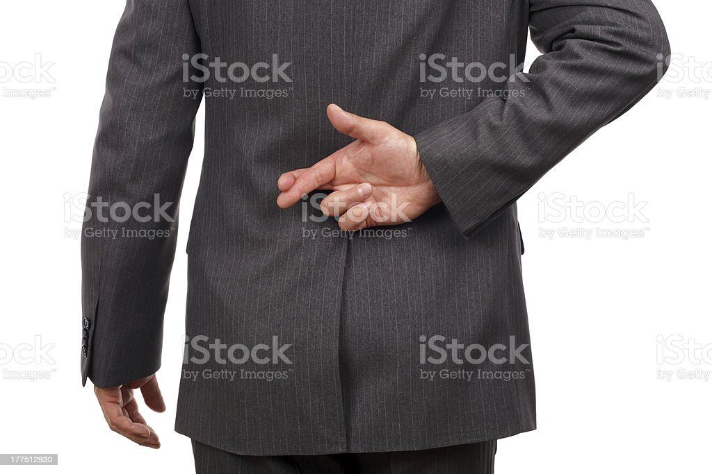 Fingers crossed behind businessmans back stock photo