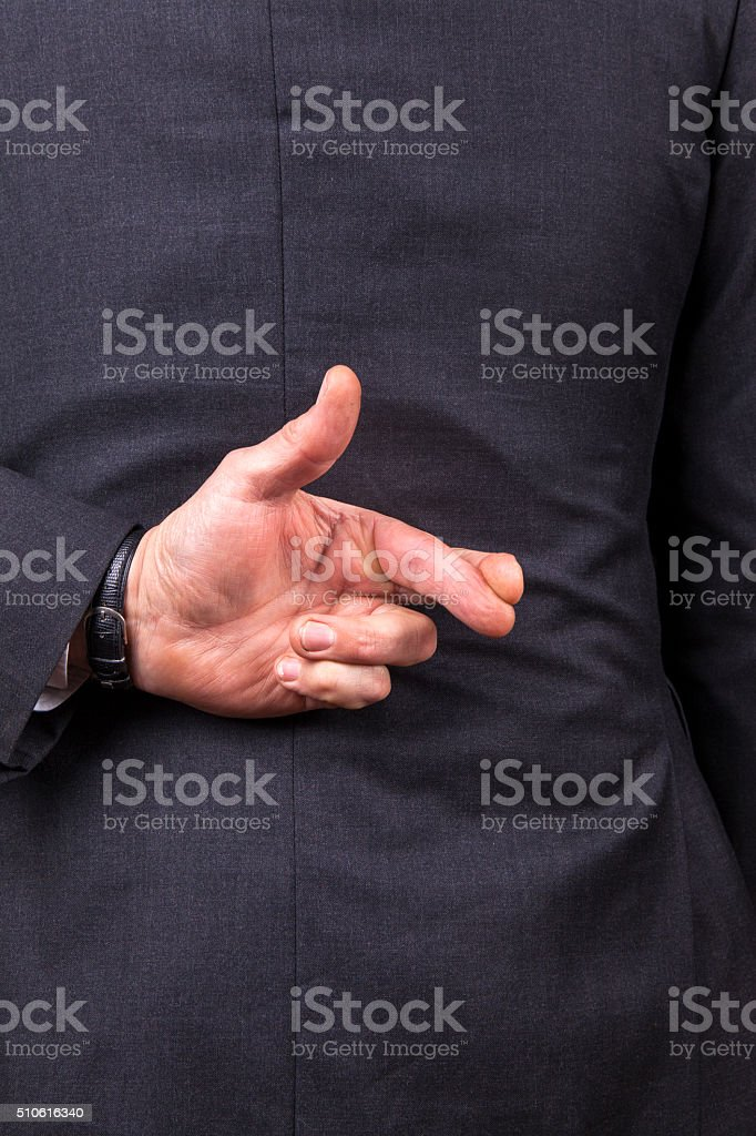 Fingers crossed stock photo