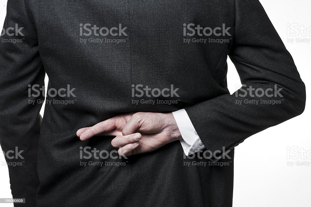 Fingers crossed - suit royalty-free stock photo