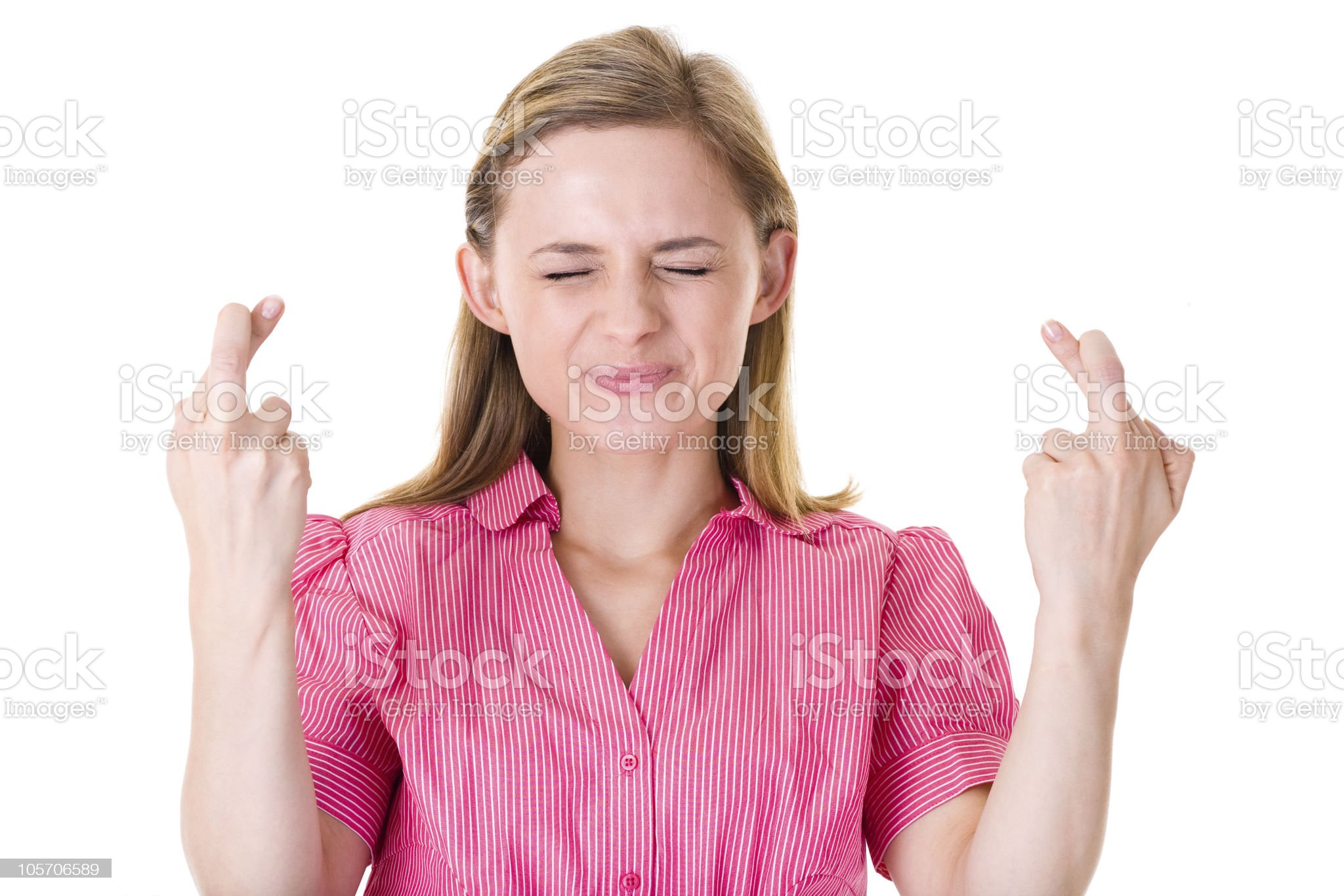 fingers crossed, wishful thinking, attractive female, isolated royalty-free stock photo