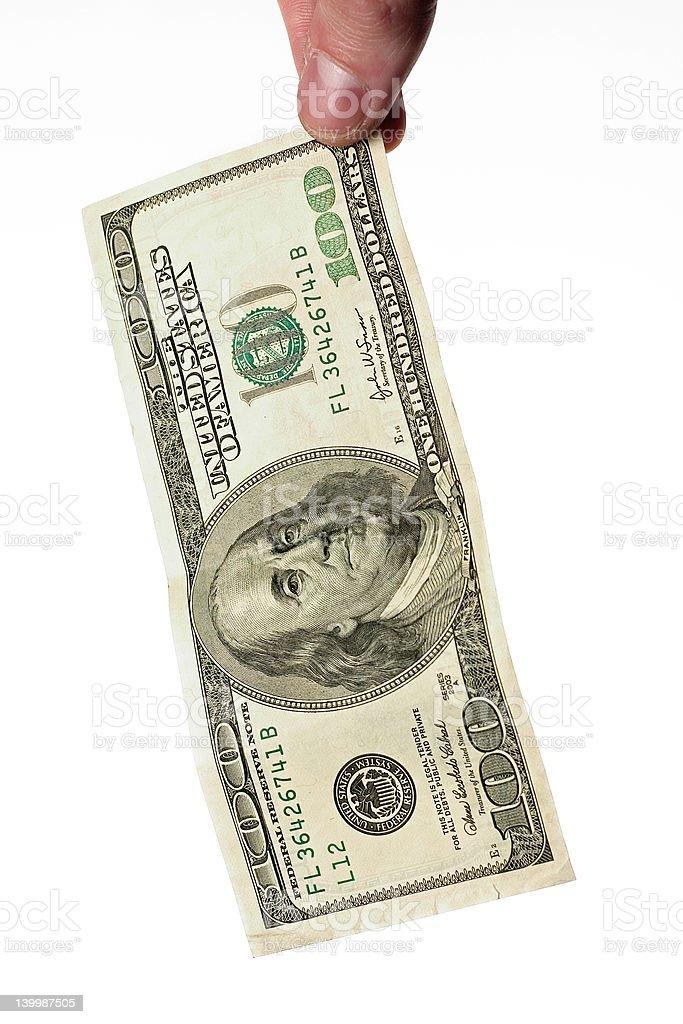 fingers holding dollars royalty-free stock photo