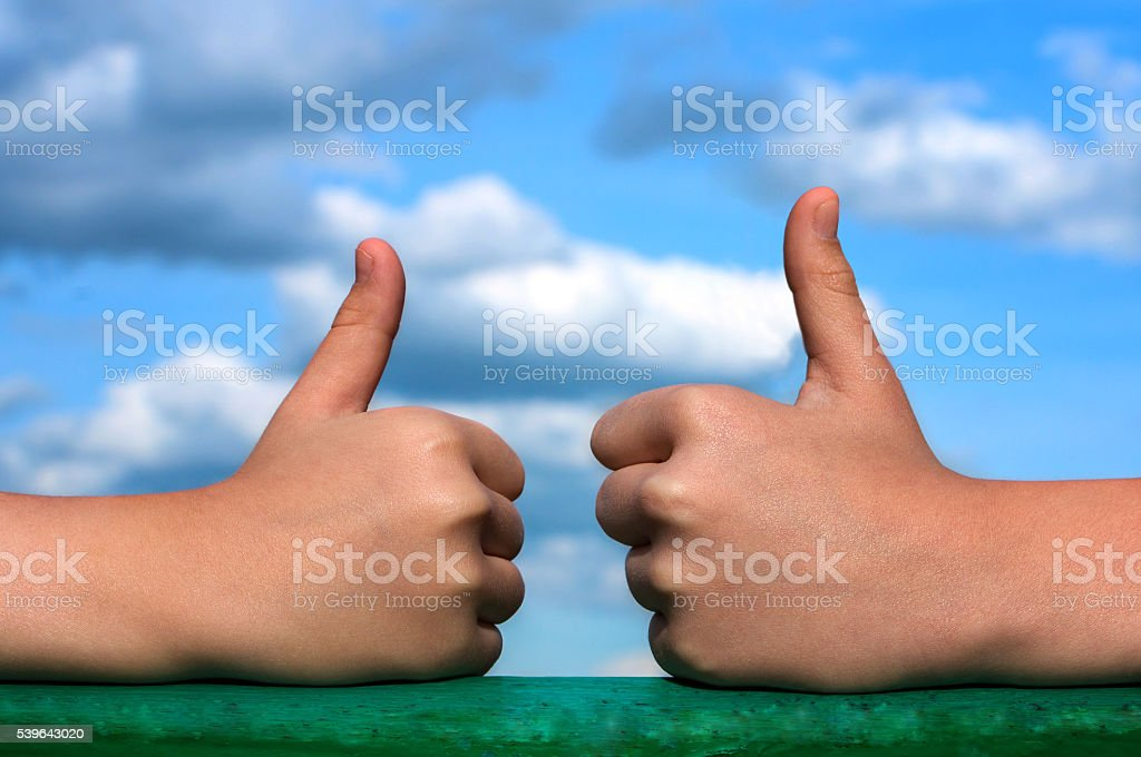 fingers in the top and all is well stock photo
