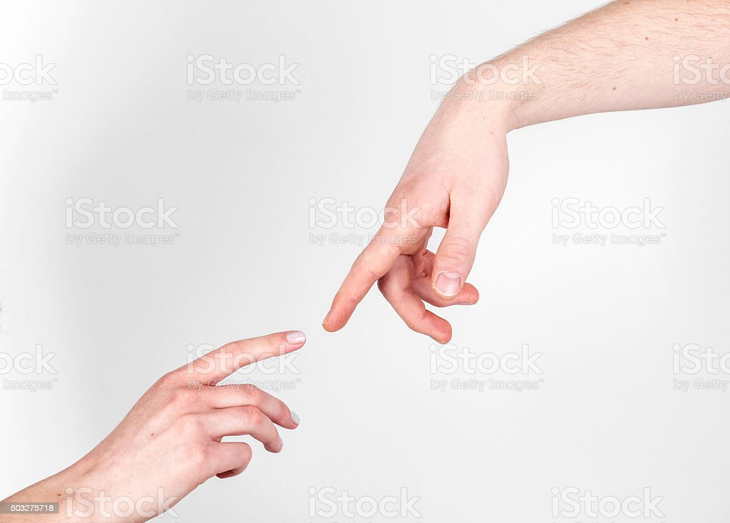 Fingers of Two People Nearly Touching stock photo