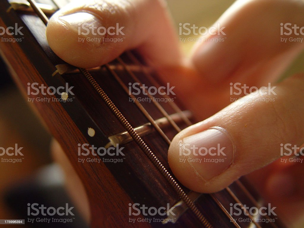 Fingers on frets royalty-free stock photo