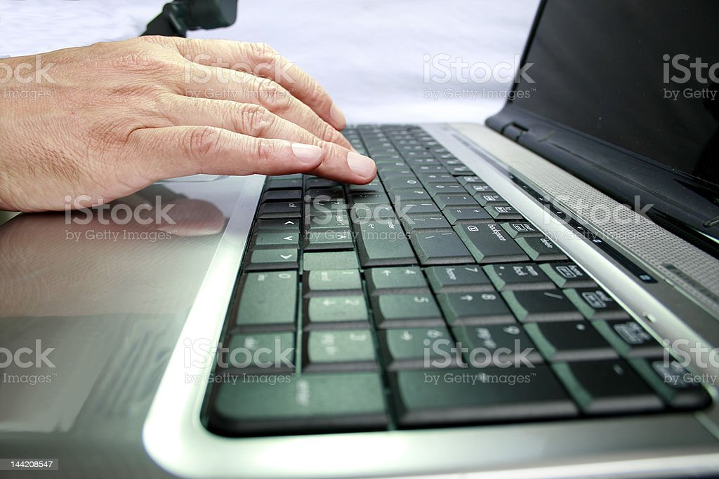 Fingers on laptop royalty-free stock photo