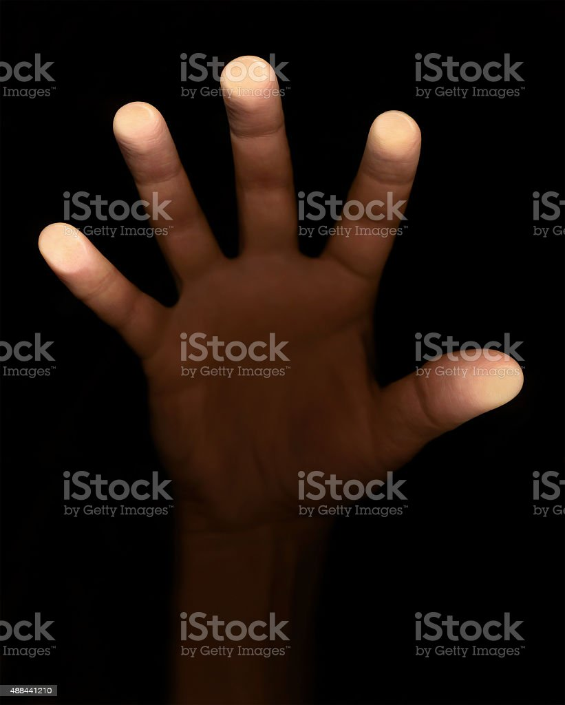 fingers touch the glass on a black background stock photo