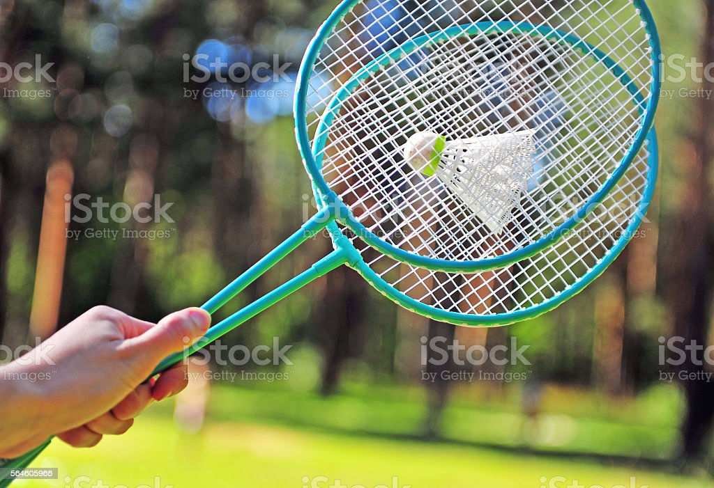 Fingers with badminton rackets stock photo