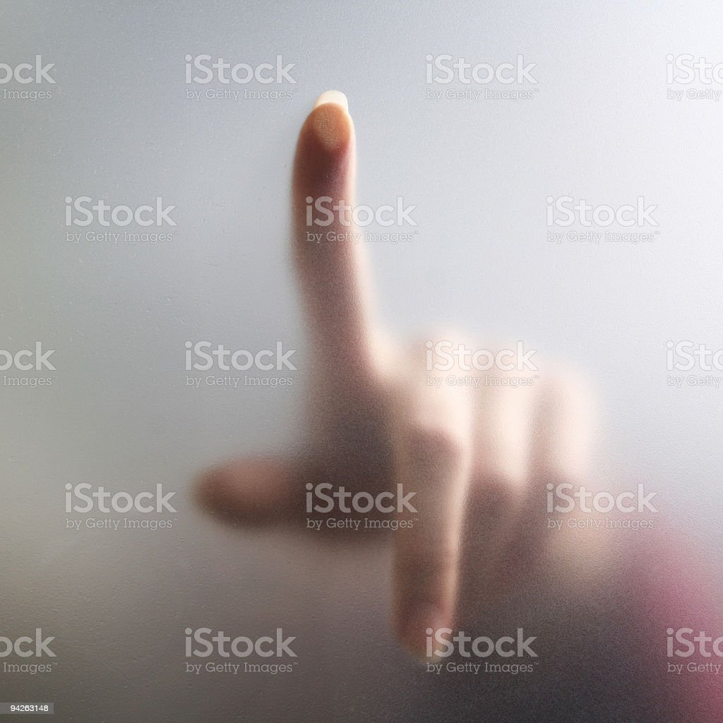 Fingertip touches fogged glass stock photo