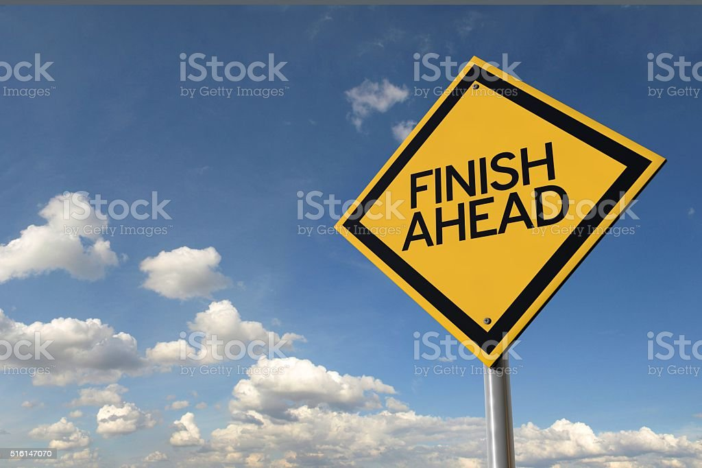 Finish ahead yellow highway road sign stock photo