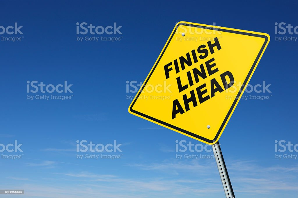 Finish Line Ahead on yellow road sign stock photo