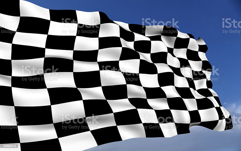 Finish line checkerboard flag waving in a blue sky stock photo