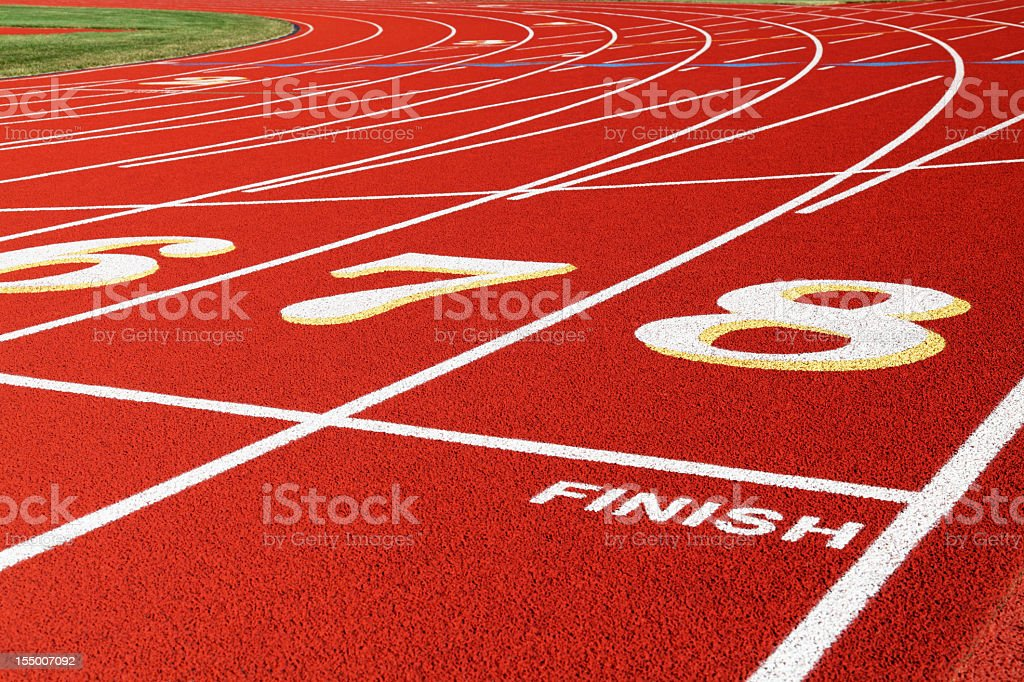 Finish Line Lanes on Red Running Race Track Closeup stock photo