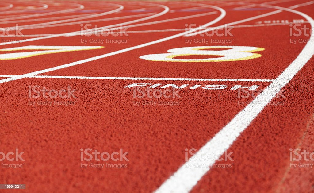 Finish Line on Red Running Track royalty-free stock photo