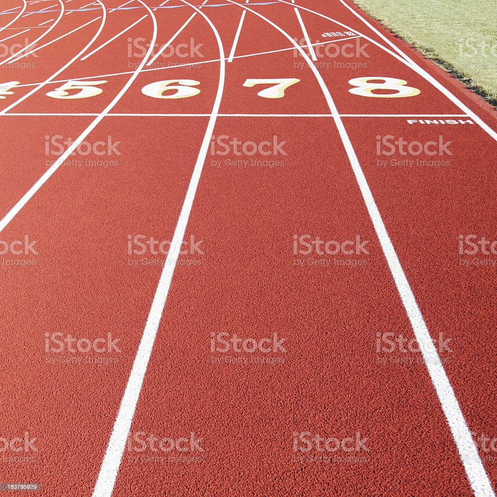 Finish Line on Synthetic Red Running Racing Track royalty-free stock photo