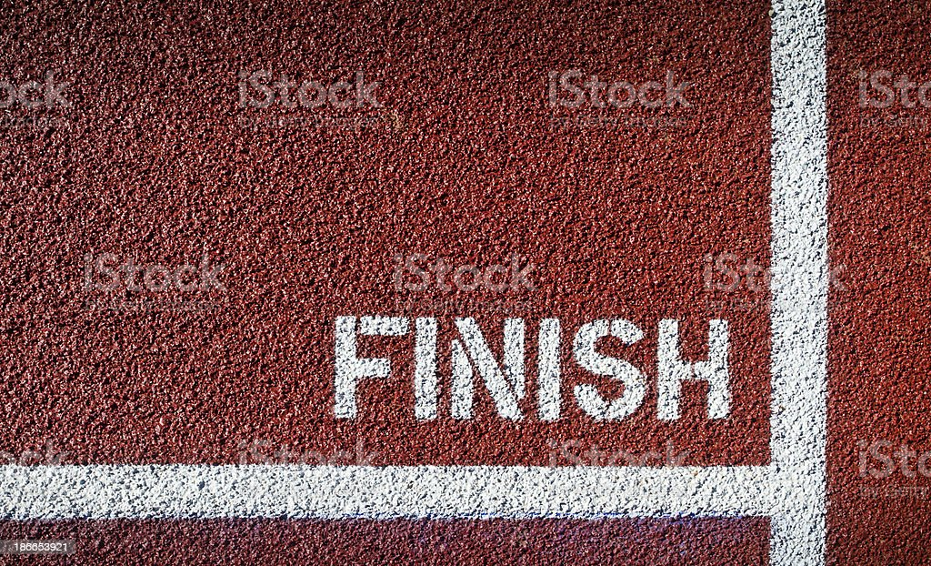 Finish painted in white on red asphalt royalty-free stock photo