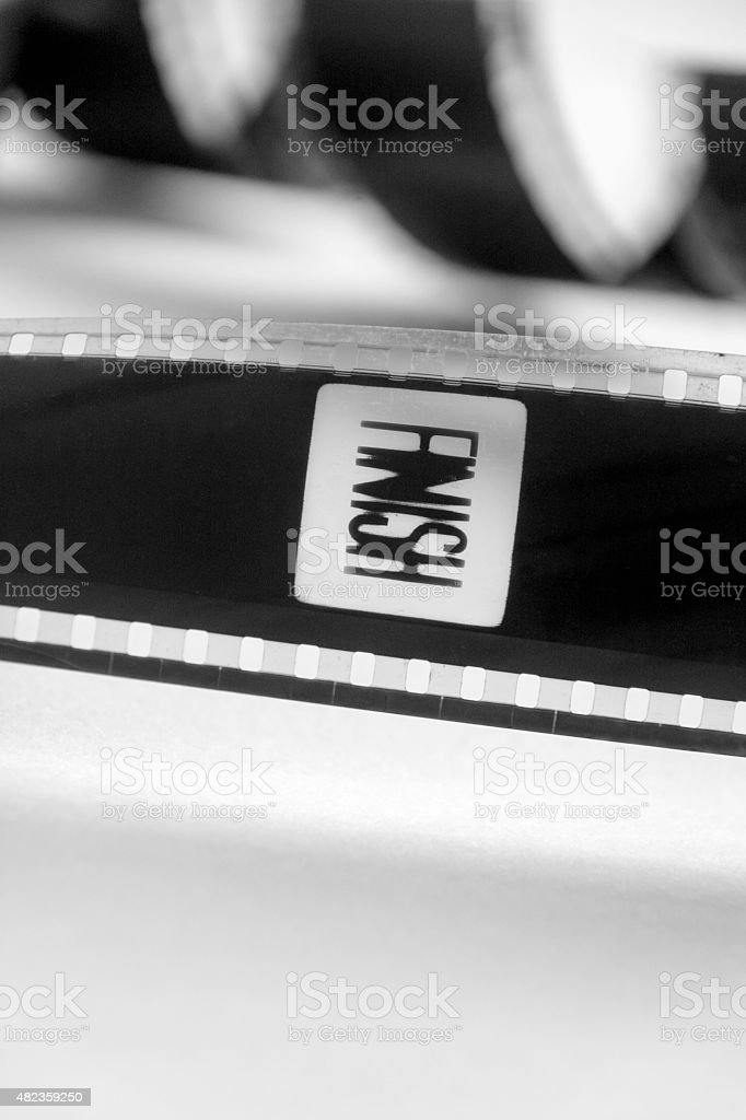 Finish  word on a frame of black and white film stock photo