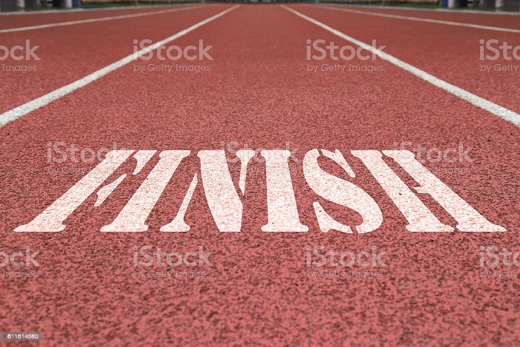 finish written on the red running track stock photo