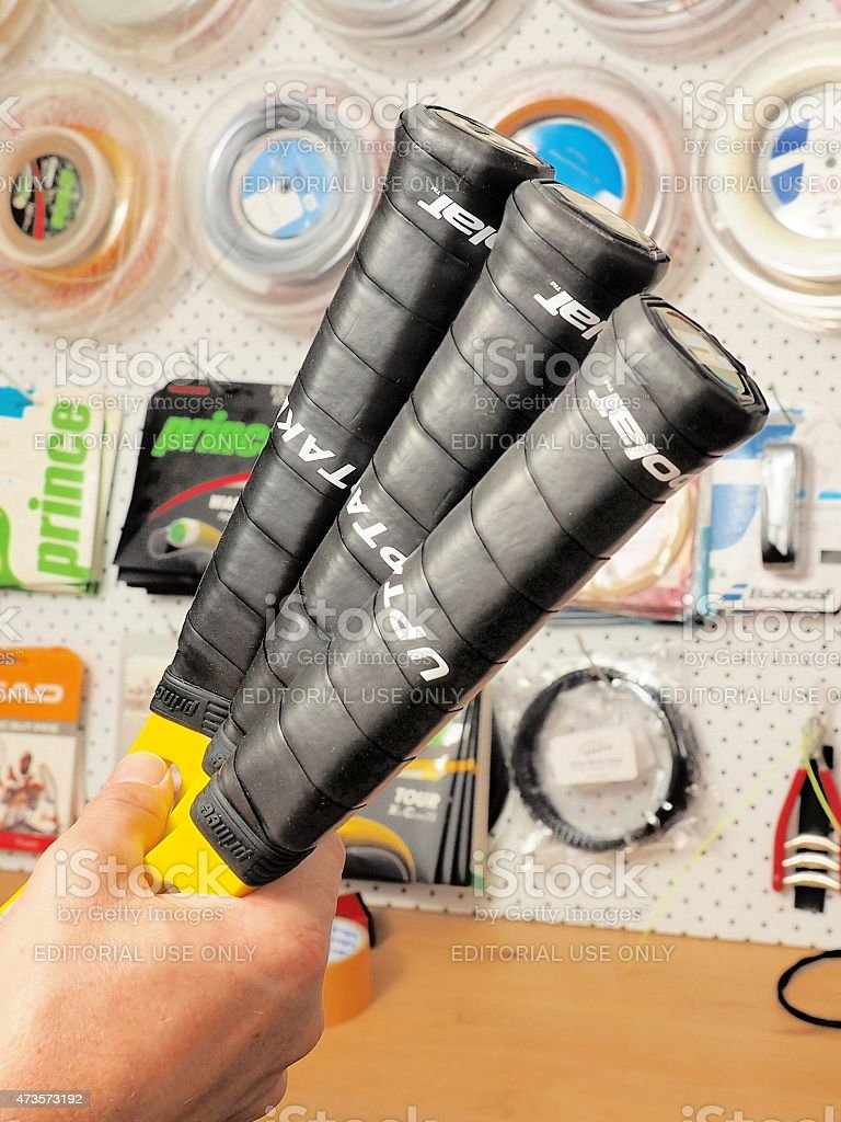 Finished base grips on 3 Tennis racquets stock photo