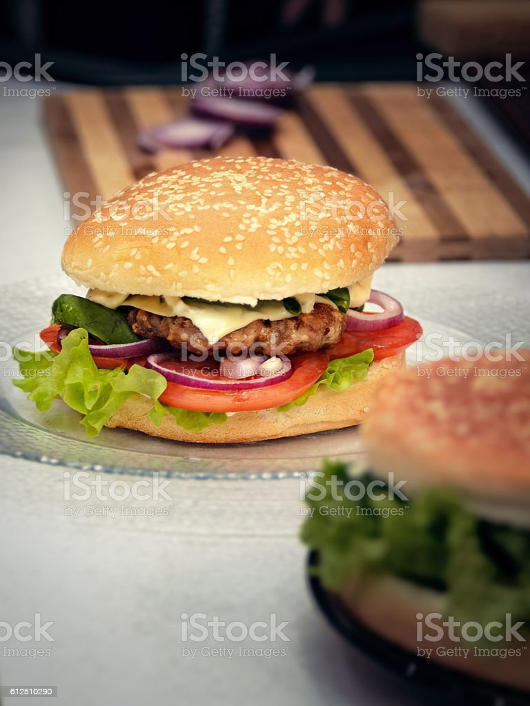 Finished hamburgers on the plate. Cooking burger concept stock photo