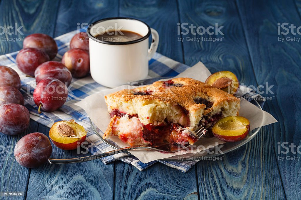 Finished pie of plumes and peaches on the wood desk stock photo