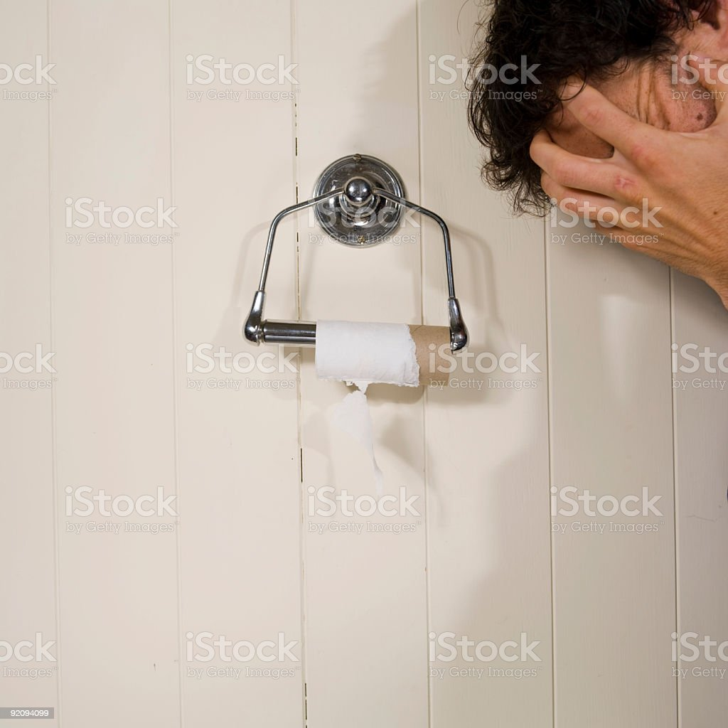 toliet roll and hand stock photo