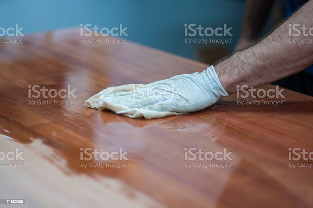 Finishing and French Polishing Wood, Timber, Furniture by Hand stock photo