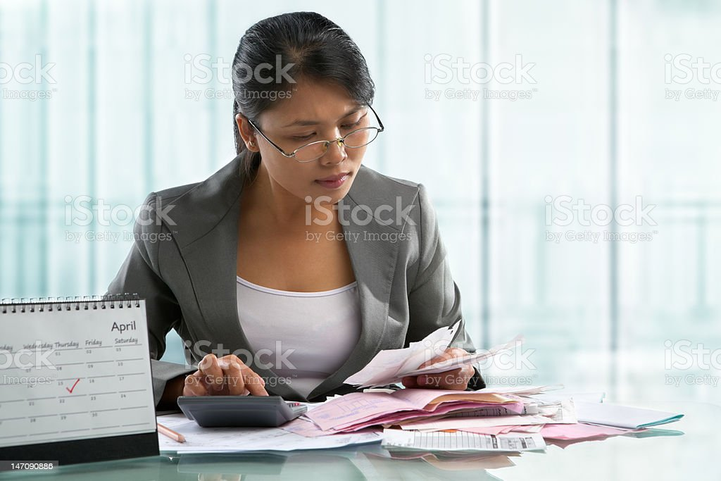 Finishing calculation for tax form on April 15 royalty-free stock photo