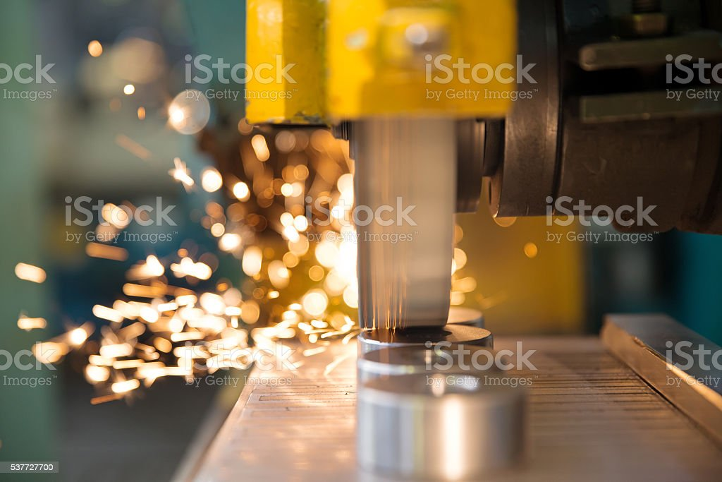 Finishing Metal Working with CNC Grinding Machine stock photo