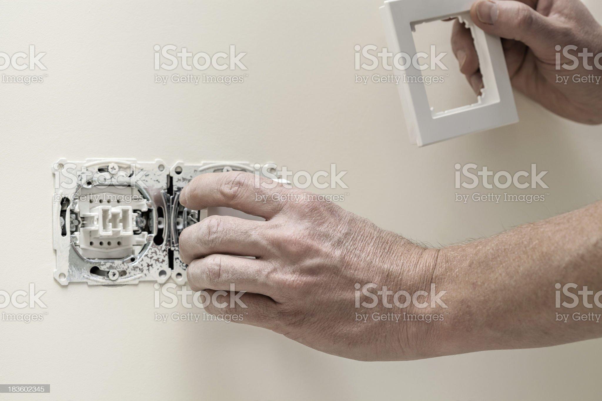 Finishing new house, light switch royalty-free stock photo