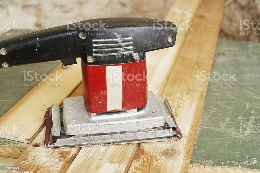 Finishing sander on wooden board royalty-free stock photo
