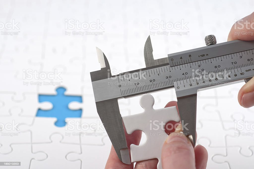 finishing the jigsaw - is it right? stock photo