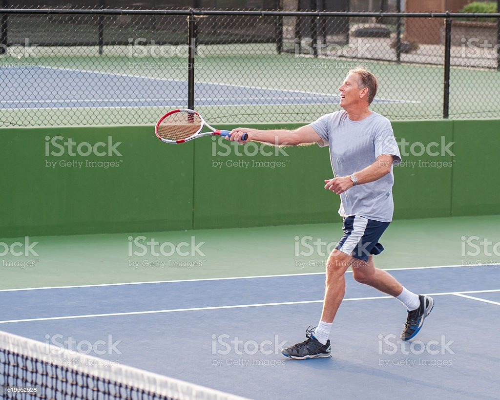 Finishing the running forehand. stock photo