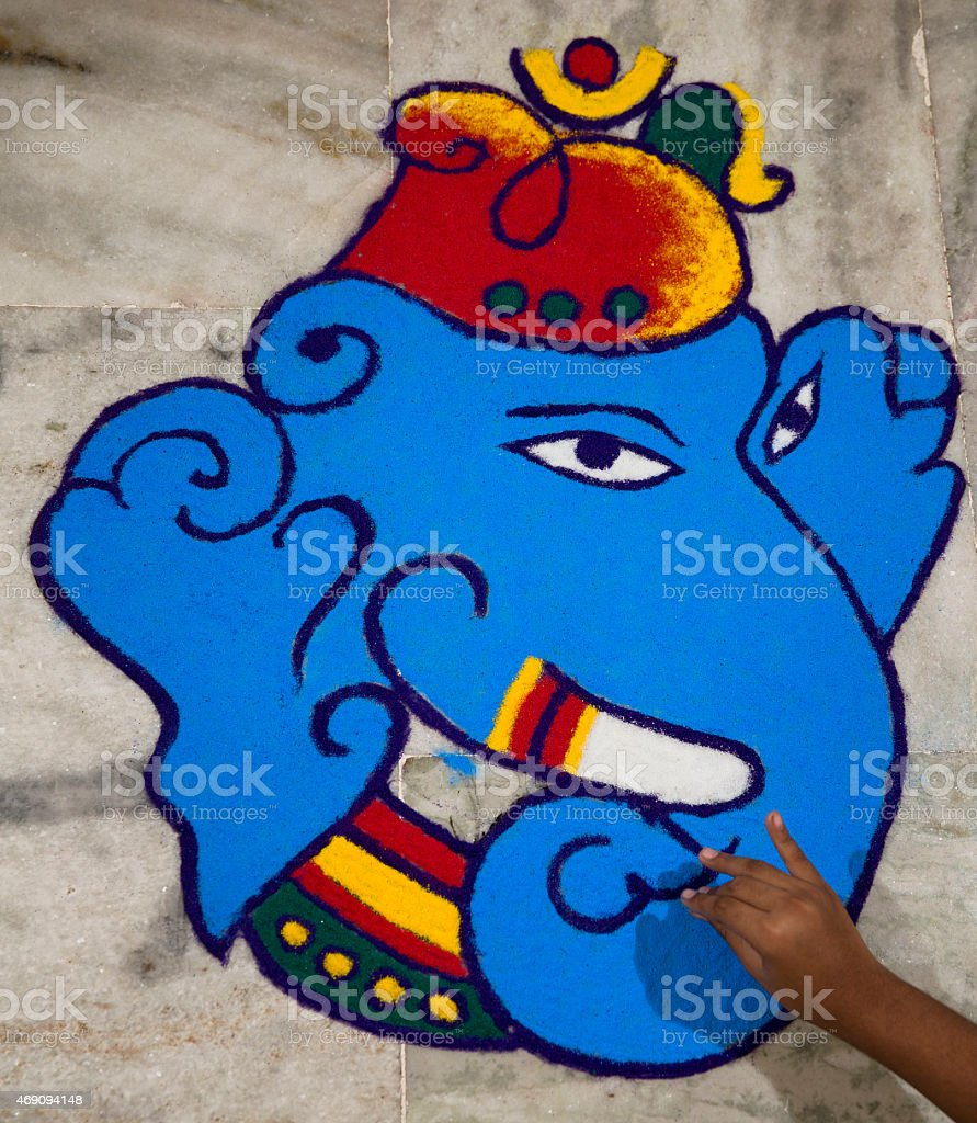 Finishing touches being given to a Rangoli on Diwali stock photo